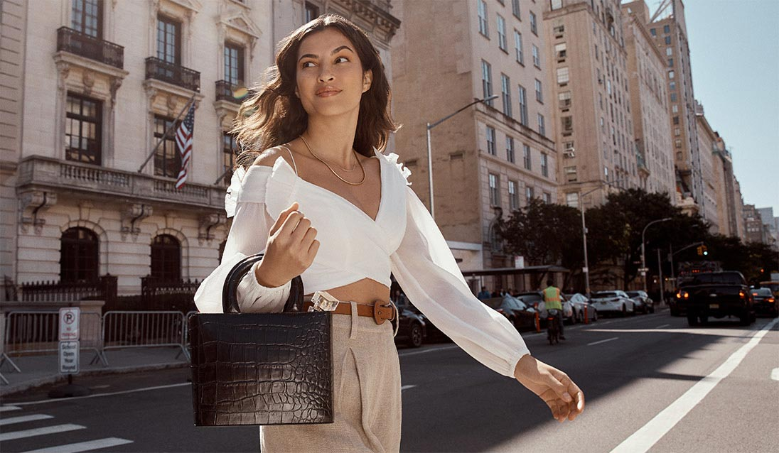 Model crossing the street with a My Fifth Avenue Fragrance